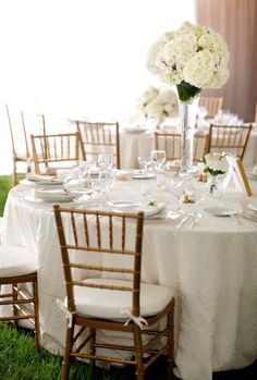 White/gold - beautiful!  Love the champagne vase that raises the flowers above the site line.