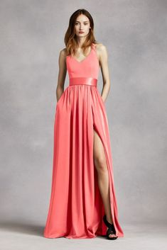 An exquisite gown that is perfect for a wedding party or any special event! V-neck halter gown with matte crepe bodice features bow detail at back. Long soft charmeuse skirt withmiddle slit an Coral Bridesmaid Dresses, Coral Dress, Bridesmaid Color, Halter Gown, Strapless Dress Formal, Bridal Party Dresses, Wedding Dresses, Gown With Slit, Poses