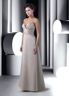 Rich satin enwraps the A-line silhouette of Da Vinci 9196 Bridesmaid Dress, drawing support from thin spaghetti straps.