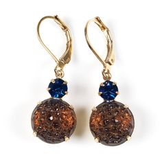 1 / 1  Midnight in St. Topaz  Midnight in St. Topaz  Vintage round sugar glass cabochon and Swarovski crystal brass settings on a goldplated leverback earwire.