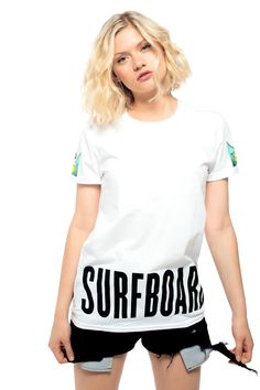 SURFBOARD EMOJI TEE $35.00 Unisex white T-shirt featuring the surfer emoji on both sleeves and surfboard at the hem.
