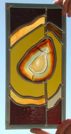 Love this idea of stained glass with a geode in the center and concoidal waves surrounding it.