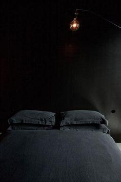 Black bedroom at the Maison Champs Elysées hotel
