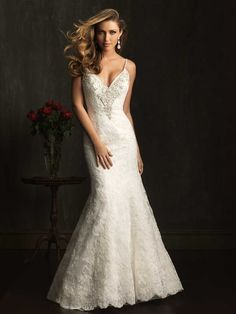Sexy Wedding dress. Allure Bridals Style: 9060. A slim, fitted gown in all-over lace. The sexy, v-shaped neckline is accented with sparkling, Swarovski crystals and has delicate spaghetti straps that continue to a deep, v-shaped back.