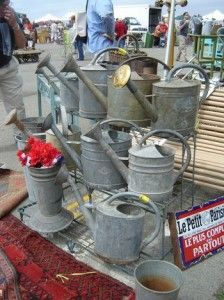 Thrift shop shopping…for the garden. Watering cans wait for new owners
