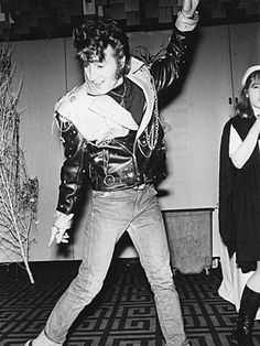 John channels Elvis at a costume party in 1968