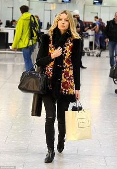 Jet set: Chris Martin's girlfriend, Annabelle Wallis looked every inch the modern lady as ...
