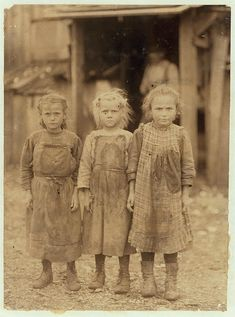 Josie, six year old, Bertha, six years old, Sophie, 10 years old, all shuck regularly. Maggioni Canning Co. Port Royal, South Carolina. 1911 Lewis Hine photo