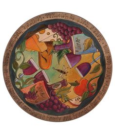 WINE & CHEESE LAZY SUSAN  $400 Artist Sarah Grant's vibrant illustration of a sumptuous spread of fruits and cheeses surrounding a bottle of wine is etched into birch or poplar wood and then hand-painted in vibrant colors. Around the edge are etched blessings and wishes for bountiful living and joyful eating. Bon appetit! Handmade in Iowa.