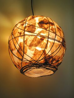 COFFEE FILTER ART - 100% Handcrafted Hanging Pendant Light Rustic Ecofriendly Lamp Shade Lighting Paper Lamp (cord set included). $75.00, via Etsy.