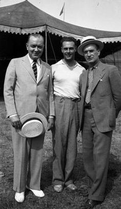 Dr. Waldo B. Diamond of Madison, Everett White aerialist, and Dr. Thomas W. Tormey of Madison. Ringling Barnum Circus, August 4, 1936.