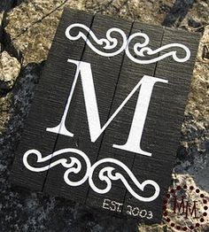 A monogram sign for the fireplace
