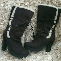 Gorgeous Chocolate  Brown Boots Man made material suede like appearance chocolate brown color. These will set you jeans off or brown leggings. Like new appearance worn just once clean even on the soles. 3 inch thick heels made for comfort. Shoes Heeled Boots