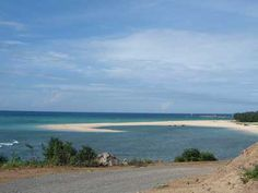 """Phu Quy Island, whose name means """"rich and precious,"""" lies about 100 km to the east of Phan Thiet City; close to the international maritime route and on the continental shelf. The Island is an important stop between the mainland and Truong Sa (Spratley Island) archipelago; 20 km further away. Its a """"floating base;"""" providing services to ships fishing offshore via its seaport on Trieu Duong Beach."""