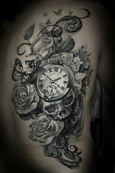 Roses, skulls, time piece, watch, butterflies tattoo