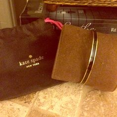 Kate spade black and gold bangle Never worn comes with dust cover. kate spade Jewelry Bracelets