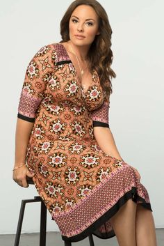 Add an interesting mix of prints in orange and pink to your collection with our plus size Beguiling Border Wrap Dress. Shop our entire collection with fabulous made in the USA styles online at www.kiyonna.com.