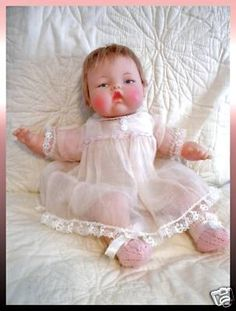 "Tiny Thumbelina doll. Turn the knob in her back, hold her and she moves her head ""like a real baby!"""