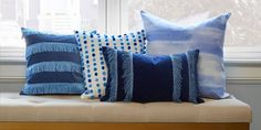 Embellish basic pillow covers with pom-poms, trim, or a wash of color.