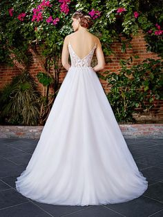 Moonlight Tango T769 ethereal lace bodice ball gown with a low, illusion lace back and flowing skirt.