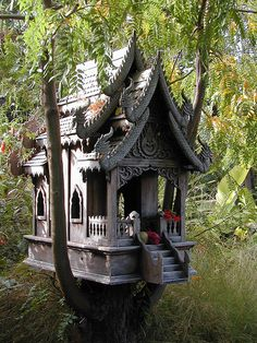a spirit house shelters protective spirits and prevents them from interfering with the living. (thai buddhism)