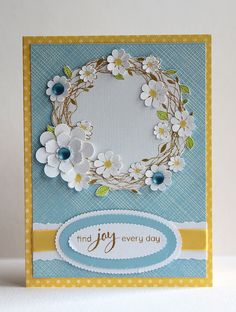 handmade card ... blue with white and yellow adornments ... sweet wreath with punched and layered flowers  ...