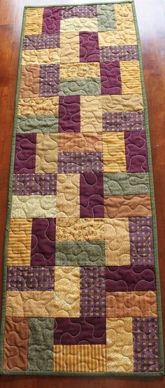 This beautiful fall quilted table runner was created with various fall fabrics. Patchwork Table Runner, Table Runner And Placemats, Table Runner Pattern, Quilted Table Runners, Fall Table Runner, Table Topper Patterns, Autumn Table, Batik Quilts, Fall Quilts