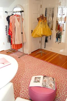 Magnetic bulletin boards and kitchen utensil hooks as tangle free necklace storage/display, and garments needing repair/alteration on a garment rack in another corner of Kelley Moore's Seattle dressing room #closet #jewelry #organization