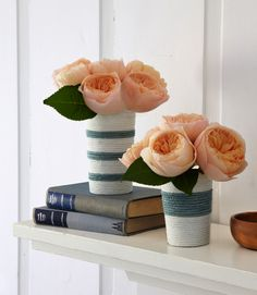These flower vases are warped in pretty shades to rope to create nautical stripes.