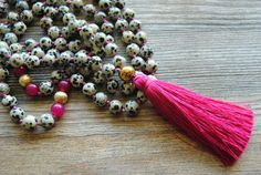 108 mala necklace, dalmatian jasper mala  Hand knotted dalmatian jaspe mala necklace with pink tassel.  This beautiful mala necklace is made of