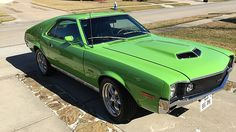 1970 AMC AMX - 1 of 4,116 AMXs produced in 1970  - Modified 390 CI engine  - 4-speed transmission  - Ram Air  - Go package  - Power steering  - Power disc brakes  - Command Air  - Black leather interior