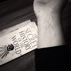 White ink dragonflies and big books. Love.