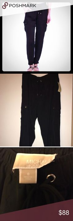 🆕 MICHAEL Michael Kors black cargo pants size 8 NWT MICHAEL Michael Kors black cargo pants. 100% polyester. Women's size 8. Features a drawstring stretchy waist, bands hems, and silver hardware. Machine wash cold. Please view all photos and ask any questions you may have prior to purchasing 💞                 ❌No Trades❌  ⭐️Bundle & Save⭐️ MICHAEL Michael Kors Pants