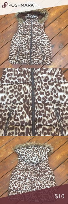 Girl's Justice Leopard Vest Girl's Justice Leopard Vest. Size:12. Very gently used. EUC. Color are brown & tan leopard print. Zipper closure. 2 zipper pockets. Faux fur detachable snap hood. Lined in brown. Very cute & cool for fall/winter & always in style! 100% polyester. Machine wash. Tumble dry. NO TRADES. Justice Jackets & Coats Vests