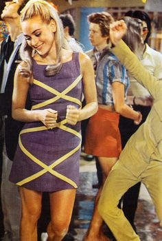 60s Fashion mini dress mod criss cross yellow grey dancing color photo print ad