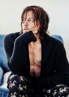 Norman. Mm. And lookit that tat.