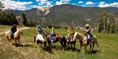Horseback riding in the mountains surrounding Red River, New Mexico
