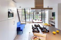 Woonhuis - Vught www.burokoek.nl/ Baksteen - Stalen kozijn - Zwart kozijn - Beton vloer - Aanbouw- Vide - Gerecycled trap - Glas- Keuken eiland