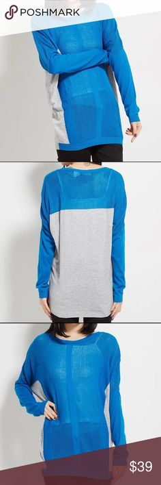 Two tone light sweater Two tone light sweaterBoutique Material: 53.3% polyester, 25.5% acrylic, and 21.2% polyamide. CATEGORY Sweaters