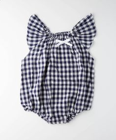 Blue and white checked romper with small bow. Fabric is a soft stretch. Metal snaps at the bottom for easy clothing change and elasticated leg holes to fit comfy around thighs. -Fits a little big- Car