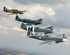 A formation of Spitfires and a Hurricane.