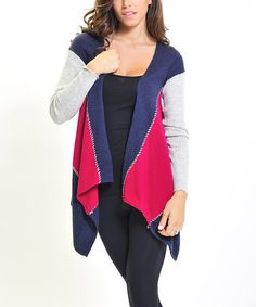 Comfy-cozy meets casual-chic on this sweet cardigan. Boasting a stylish sidetail silhouette and on-trend color blocking, it's a layer luxe enough to love.55% nylon / 38% acrylic /7% angoraHand wash; dry flatImported
