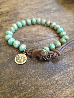 Boho Jewelry, Boho Elephant Bracelet : This elephant bracelet features beautiful green-turquoise picasso Czech beads hand knotted with dark brown nylon cord. A pretty bronze lotus charm dangles from… Bohemian Jewelry, Beaded Jewelry, Jewelry Bracelets, Handmade Jewelry, Silver Bracelets, Diy Jewelry, Bohemian Bracelets, Jewelry Making, Handmade Wire