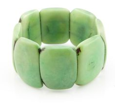 Our eco friendly LUCIA Bracelet is made from thick slices of the Tagua seed that are fully polished to remove all of the shell, creating this sleek finish. The seed itself has natural patterns that make this bracelet truly one of a kind. Color - Light Green  You might also be interested in our:  SACHA Ivory / Natural Necklace - https://www.etsy.com/listing/118503392/ivory-white-sacha-style-natural-tagua  LUCIA Light Pink Bracelet…