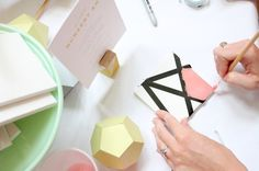 Geometric Minimalism - For Kelly's shower.   Have guests paint square tiles in similar colors, then put all squares together in one frame for the nursery | 16 Ingenious Baby Shower Themes