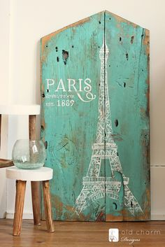and the painting continues. this time … inspired by paris! after piecing these two pieces of wood together and painting them an amazing aqua blue, this piece was crying out to have the effiel tower painted on it. these two pieces of wood are especially amazing and the aqua color just makes all the imperfections truly …