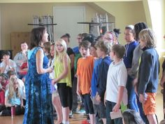 Grade 4 students perform a song for Grade 8 and the school at the Rose Ceremony. 2014-15