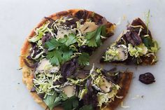 Socca flatbreads with caramelised onions, brussels sprouts and hummus – Recipes – Bite