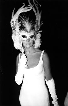 1966. Ludmilla Tchérina teases and entrances as she hides behind an elaborately whimsical mask.