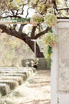 pretty white screen at aisle entrance with hydrangeas